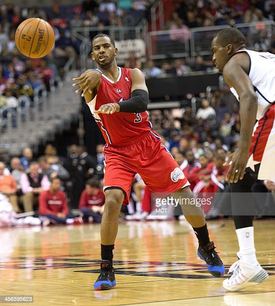 Los Angeles Clippers point guard Chris Paul passes the all while being guarded by Washington Wizards small forward Martell Webster during the first...