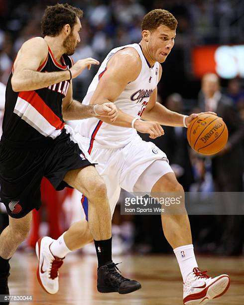 Los Angeles Clippers power forward Blake Griffin drives past Portland Trail Blazers shooting guard Rudy Fernandez at the Staples Center on October...