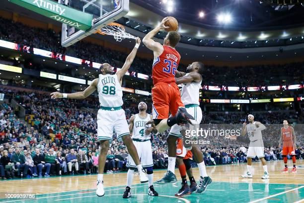 Los Angeles Clippers power forward Blake Griffin goes to the basket against Boston Celtics center Jason Collins and Boston Celtics power forward Jeff...