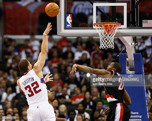Los Angeles Clippers power forward Blake Griffin shoots over Portland Trail Blazers power forward Marcus Camby at the Staples Center on October 27...
