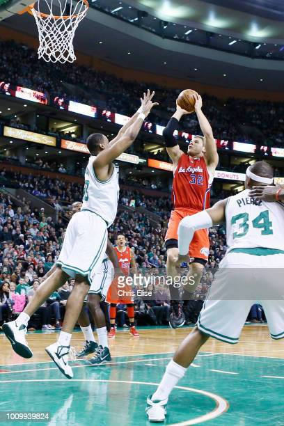 Los Angeles Clippers power forward Blake Griffin takes a jumpshot over Boston Celtics center Jason Collins during the Boston Celtics 106-104 victory...