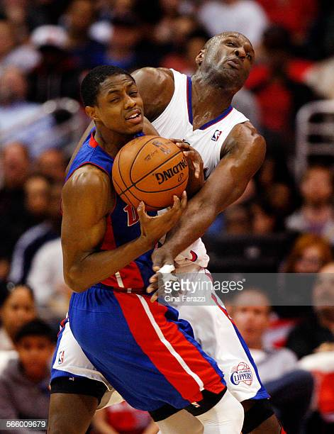 Los Angeles Clippers power forward Lamar Odom collides with Detroit Pistons point guard Brandon Knight while playing tight defense in the first half...