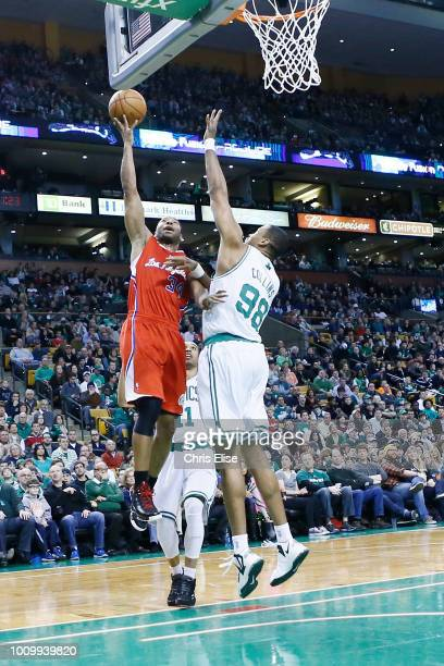 Los Angeles Clippers shooting guard Willie Green goes for the layup over Boston Celtics center Jason Collins during the Boston Celtics 106-104...