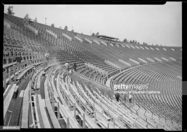 Los Angeles Coliseum, men painting seats, Los Angeles, California, 1925.