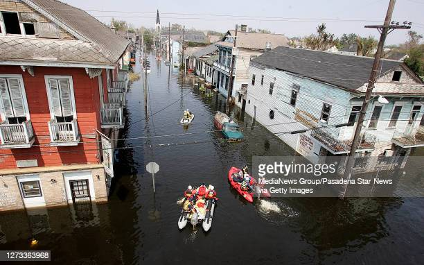 Los Angeles County and Los Angeles City Swift Water Urban Search and Rescue Teams head up Orleans St. In search of victims during the aftermath of...