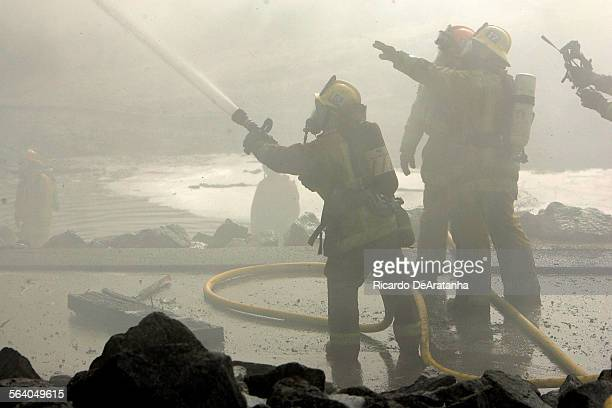 Los Angeles County and Montebello firefighters battled a stubborn blaze today that damaged a bridge spanning the Rio Hondo flood–control channel in...