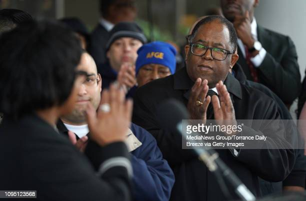 Los Angeles County Board of Supervisors member Mark RidleyThomas right applauds a speaker at a press conference for the American Federation of...