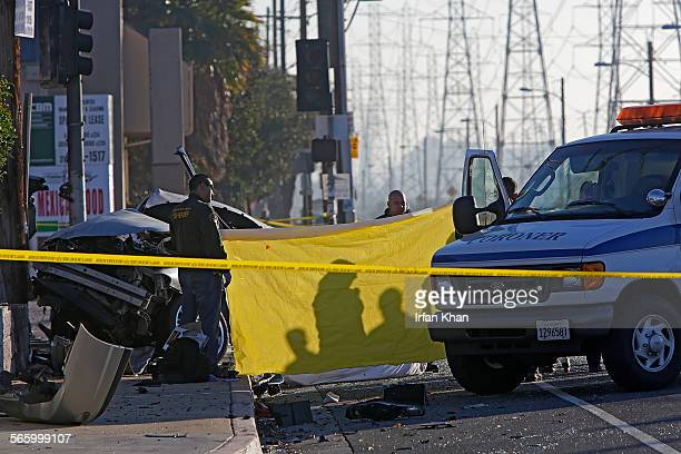 Los Angeles County coroner removing the body of a female driver of a silver car hit by a car fleeing from Los Angeles County sheriff deputies Four...