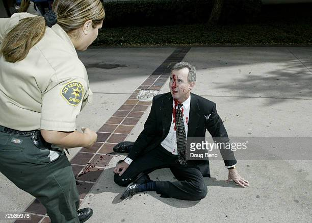 Los Angeles County deputy tells attorney Jerry Curry to lie down after he was shot outside the Los Angeles County Court House on October 31 2003 in...