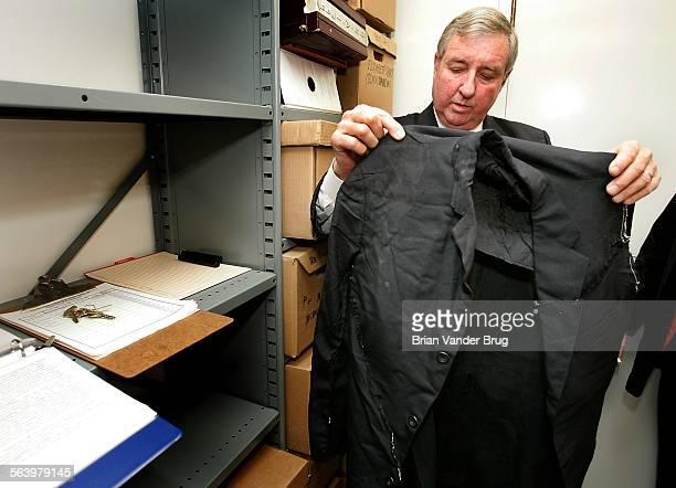 Los Angeles County District Attorney Steve Cooley inside historical evidence vault holding suit worn by Bobby Kennedy on the night of his...