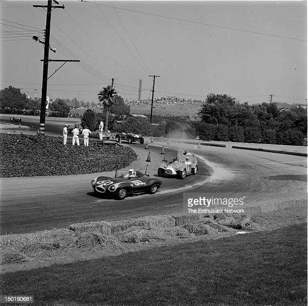Los Angeles County Fair Grounds Pomona Road Race June Bill Krause in his DType Jaguar leads the pack through the turn
