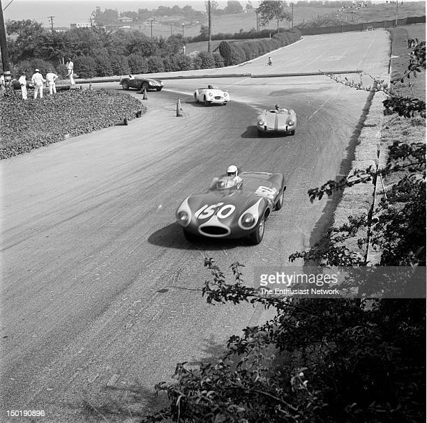 Los Angeles County Fair Grounds Pomona Road Race June Bill Krause in his DType Jaguar leads Ken Miles' Porsche 550 Dick Seagle's Triumph TR2 and John...