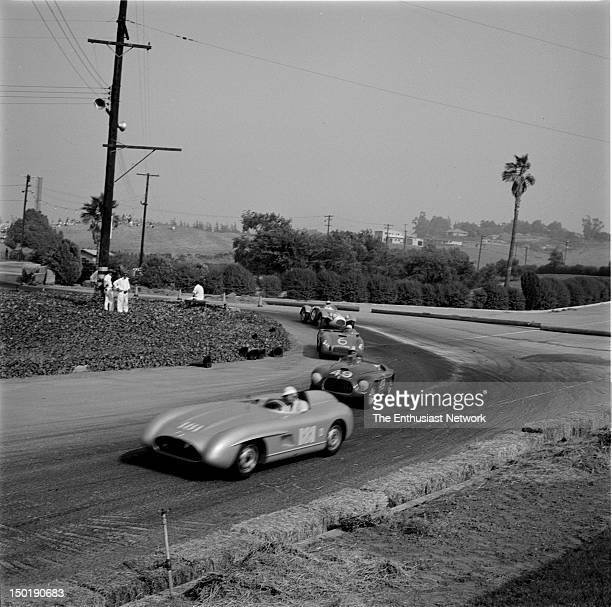 Los Angeles County Fair Grounds Pomona Road Race June Chuck Porter in his Mercedes 300 SLS with Bob Drake's Ferrari 166 MM next to him in a righthand...