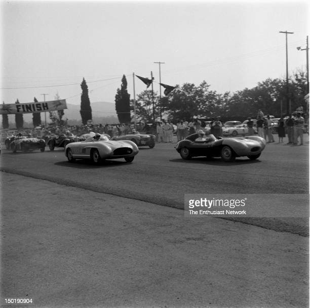 Los Angeles County Fair Grounds Pomona Road Race June Chuck Porter's Mercedes 300 SLS trails Jerry Austin in his Jaguar DType at the startfinish line
