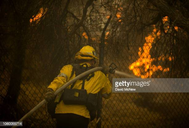 Los Angeles County firefighters attack flames approaching the Salvation Army camps in Malibu Creek State Park during the Woolsey Fire on November 10...