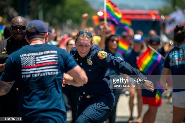 Los Angeles County firefighters dance in the annual LA Pride Parade in West Hollywood, California, on June 9, 2019. - LA Pride began on June 28...