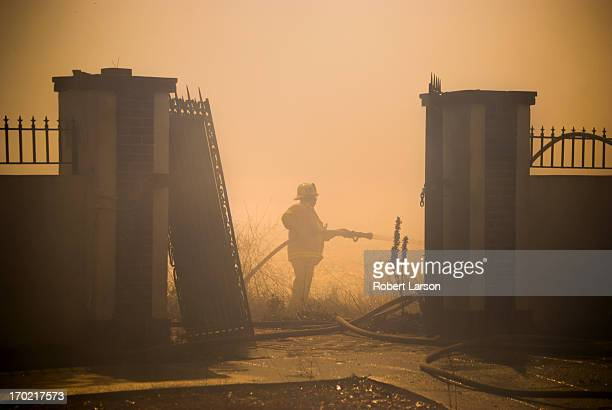 CONTENT] Los Angeles county firefighters from Station 69 fight a brush fire along the bluffs above Highway 1 / Pacific Palisades California / October...