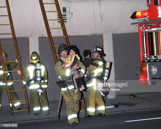 Los Angeles County Firefighters rescue two children from their smoke filled apartment near Huntington Park.