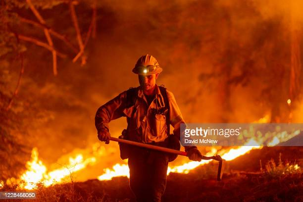 Los Angeles County firefighters, using only hand tools, keep fire from jumping a fire break at the Bobcat Fire in the Angeles National Forest on...