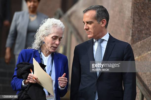 Los Angeles County Public Health director Barbara Ferrer and Los Angeles Mayor Eric Garcetti speak as they arrive for a press conference on the novel...