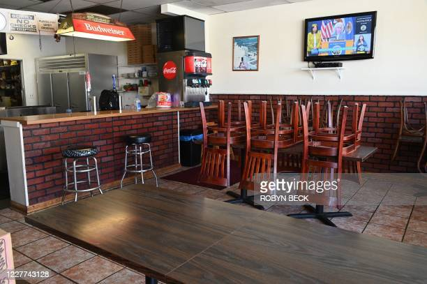 Los Angeles County Public Health Director Barbara Ferrer speaks during a news conference July 22, 2020 seen on a television in an empty pizza...