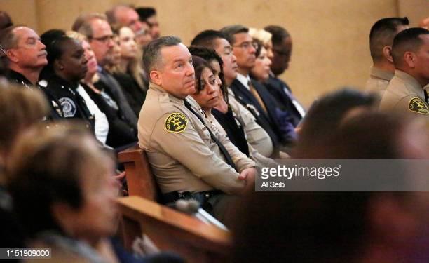 Los Angeles County Sheriff Alex Villanueva center during a memorial service for Los Angeles County Sheriff's Deputy Joseph Solano June 24 2019 at...