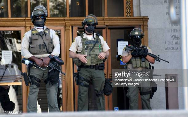 Los Angeles County Sheriff deputies look on as Demonstrators protest in front of the Hall of Justice after the death of George Floyd in Los Angeles...