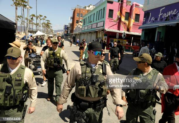 Los Angeles County Sheriff deputies with the Homeless Outreach Services Team patrol Ocean Front Walk to assess the homeless situation in Venice on...