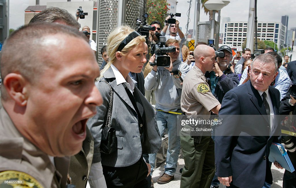Los Angeles County Sheriff deputy Langlais, left, yells at