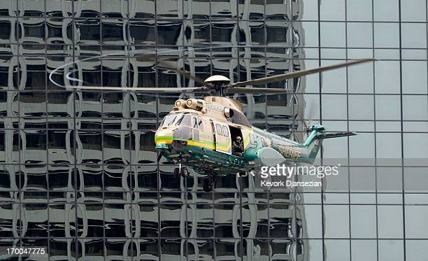 Los Angeles County Sheriff helicopter with SWAT team members deploys during a drill involving a response to threats of a weapon of mass destruction...