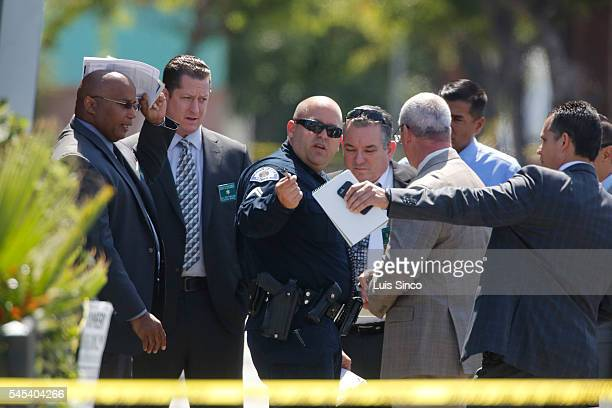 Los Angeles County Sheriff investigators and Bell police officers sort out the details after a male domestic violence suspect was shot in front of a...