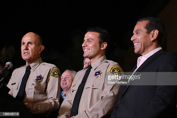 Los Angeles County Sheriff Lee Baca introduces Los Angeles County Reserve Deputy Sheriff Shervin Lalezary talks to reporters as the officer who...