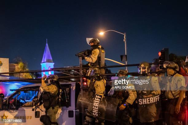 Los Angeles County Sheriff officers disperse demonstrators protesting over the lack of criminal charges in the police killing of Breonna Taylor in...