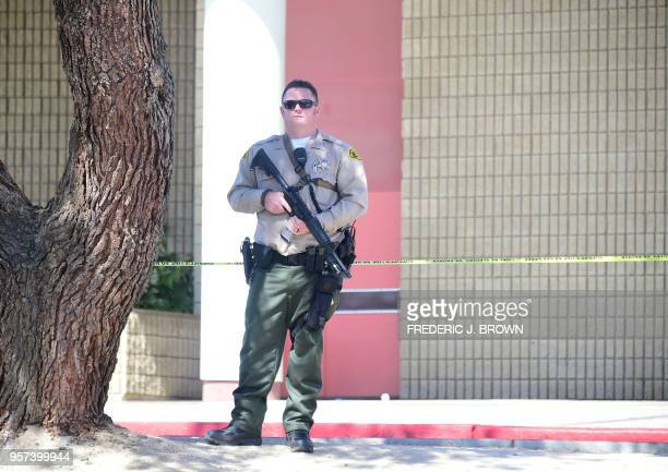 A Los Angeles County Sheriff stands guard in front of the school on May 11 2018 following reports of shooting at Highland High School in Palmdale 40...
