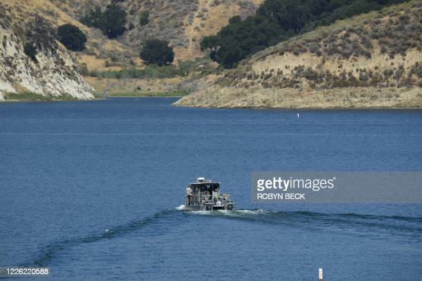 A Los Angeles County Sheriff's Department boat is seen on Lake Piru as it aids in the effort to find actress Naya Rivera on July 10 2020 in Piru near...