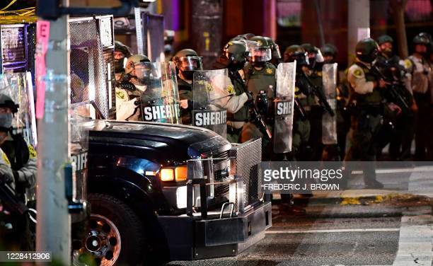 Los Angeles County sheriff's deputies move in to disperse a crowd of demonstrators gathered to protest again in the wake of Dijon Kizzee's killing,...