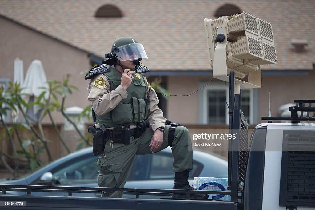 A Los Angeles County Sheriffs deputy in riot gear stands