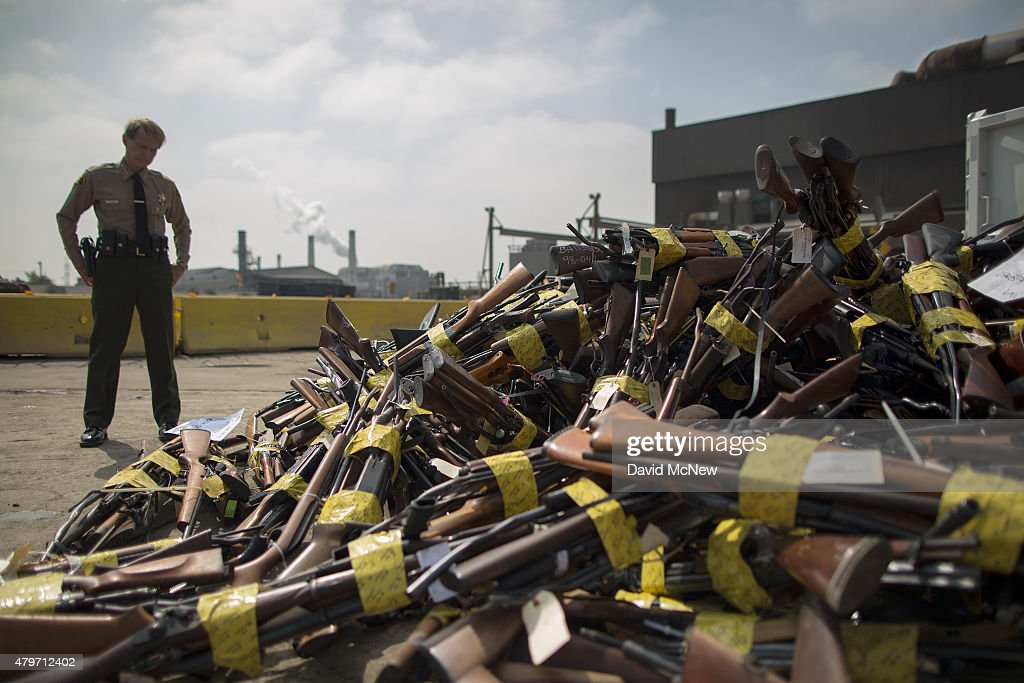 A Los Angeles County Sheriffs deputy looks at a pile of guns during the destruction of approximately 3,400 guns and other weapons at the Los Angeles County SheriffsÕ 22nd annual gun melt at Gerdau Steel Mill on July 6, 2015 in Rancho Cucamonga, California. The weapons, confiscated in various law enforcement operations, will be recycled in the form of steel rebar to be used in construction. California law requires the destruction of the confiscated weapons.