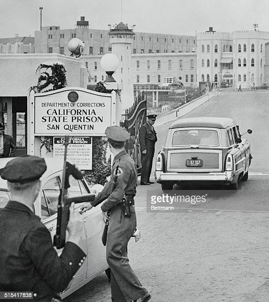 Los Angeles County Sheriff's van passes through gates of San Quentin Prison bearing convicted killers Jack Santo and Emmett Perkins closer to death...
