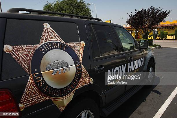 Los Angeles County sheriffs vehicle that advertises for recruits is parked in the parking lot of the Maywood police department as sheriffs deputies...