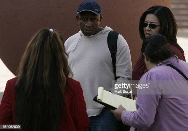 – Los Angeles County Social Worker Sonny Okereke Mental Health Service Cooridinator Lisa Wong and Social worker Lucia Navarro approach homeless...