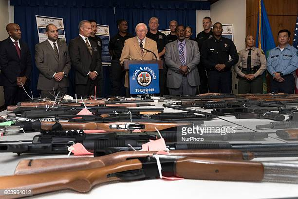 Los Angeles County Supervisor Michael D Antonovich speaks during a press conference that displayed 75 guns confiscated from felons in probation...