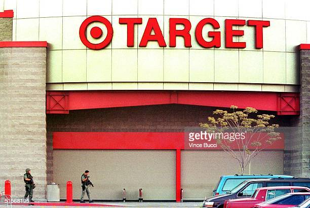 Los Angeles county SWAT officers patrol outside the front entrance of a Target department store after wouldberobbers two of them dressed in Target...