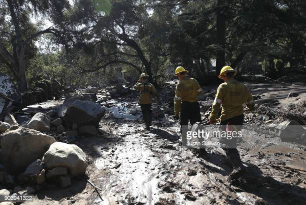 Los Angeles County urban search and rescue team search a neighborhood that was destroyed by a mudslide on January 11 2018 in Montecito California 17...
