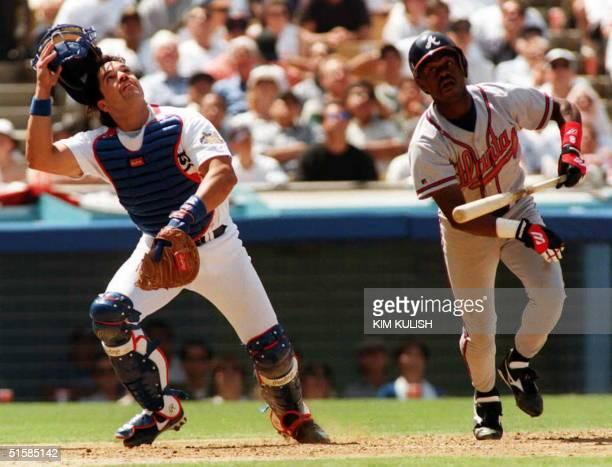 Los Angeles Dodger catcher Mike Piazza reacts to a pop fly ball off the bat of Atlanta Braves Marquis Grissom 08 April in Los Angeles, California....