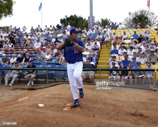 Los Angeles Dodger Hideo Nomo warming up prior to game vs. St. Louis Cardinals at Dodgertown,Vero Beach, Florida.