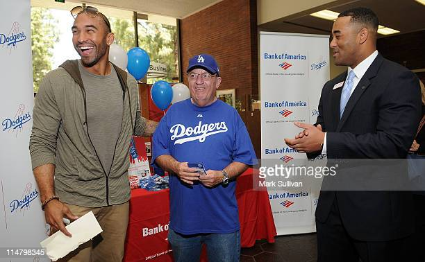 Los Angeles Dodger Matt Kemp Bank of America customer Norm Angelheart and Bank of America Regional Consumer Executive Barry Simmons pose at the...