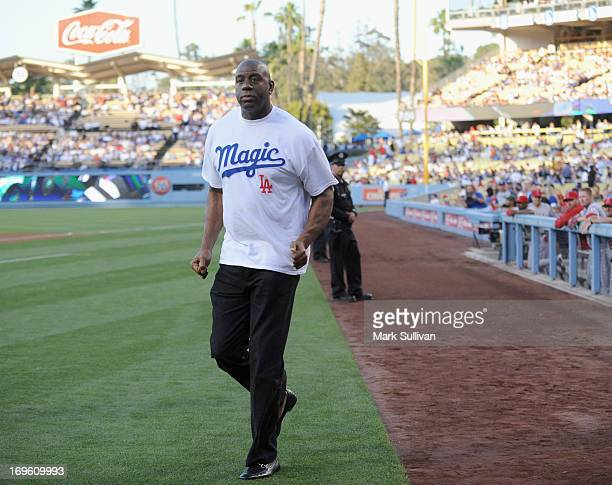 Los Angeles Dodger partner Earvin 'Magic' Johnson on the field during Magic Johnson T-Shirt night before the game between the Los Angeles Dodgers and...