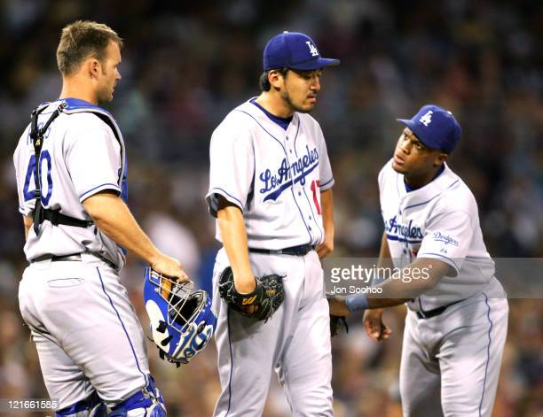 Los Angeles Dodgers Adrian Beltre consoles teammate Kazuhisa Ishii before getting pulled in the 7th inning at PETCO Park in San Diego California on...