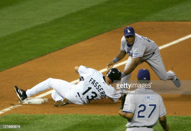 Los Angeles Dodgers Adrian Beltre tags out Colorado Rockies Jeff Fassero during the game against the Colorado Rockies at Coors Field in Denver...